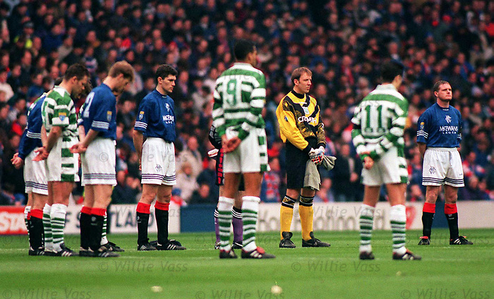 Rangers and Celtic players observe a minutes silence prior to kick off in 1995 at Ibrox