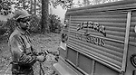 September 2, 1987 Buck Meadows, California &ndash; Stanislaus Complex Fire -- Sierra Hotshots Captain Mike Freed gets more equipment from his truck. The Stanislaus Complex Fire consumed 28 structures and 145,980 acres.  One US Forest Service firefighter, David Ross Erickson, died from a tree-felling accident. <br /> <br /> Sierra Hotshots Captain 15-A Mike Freed