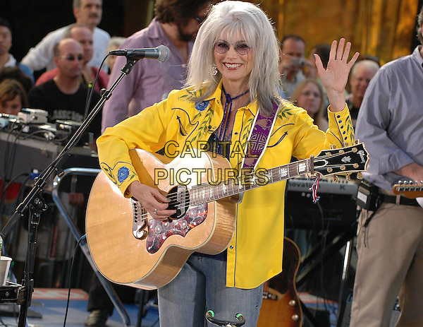 EMMY LOU HARRIS.Performs with Elvis Costello on the Today Show.Rockefeller Center, Manhattan.New York, 22nd July 2005.stage gig music juitar half length half-length white hair sunglasses yellow shirt wave waving.www.capitalpictures.com.sales@capitalpictures.com.© Capital Pictures.