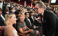 Oscar&reg; nominees Margot Robbie and Gary Oldman greet each other during the live ABC Telecast of the 90th Oscars&reg; at the Dolby&reg; Theatre in Hollywood, CA on Sunday, March 4, 2018.<br /> *Editorial Use Only*<br /> CAP/PLF/AMPAS<br /> Supplied by Capital Pictures
