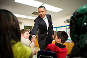 "United States President Barack Obama  visits with sixth grade students at the Graham Road Elementary School in Falls Church, Virginia on Tuesday, January 19, 2010. Following his meeting with students the President will deliver remarks on his ""Race To The Top"" program and his request for an additional $1.35 billion in 2011 for the program. .Credit: Kristoffer Tripplaar / Pool via CNP"