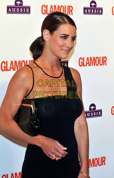KIRSTY GALLACHER .Glamour Women of The Year Awards 2009, Berkeley Square Gardens, London, England, June 2nd 2009..half length black one shoulder ponytail beige sheer see through dress nipple breasts no bra braless boobs clutch bag sleeveless side profile .CAP/PL.©Phil Loftus/Capital Pictures