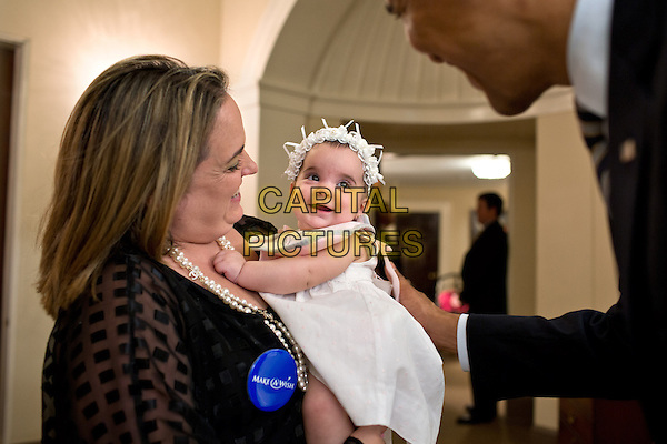 """United States President Barack Obama greets the family of Make-A-Wish child Francisco """"Paqui"""" Lopez Pena, outside the Oval Office of the White House in Washington, D.C., August 6, 2012. .half length white dress kid baby child.CAP/ADM/CNP.©CNP/ADM/Capital Pictures."""