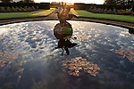The fountain on the grounds provided great reflections of the morning clouds above.