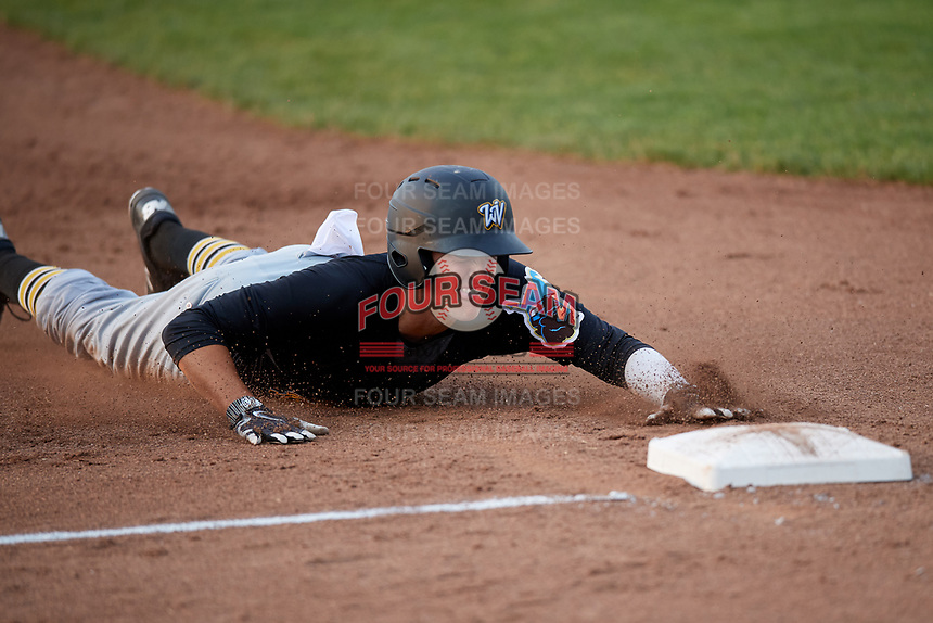 West Virginia Black Bears shortstop Connor Kaiser (59) slides into third base during a game against the Batavia Muckdogs on July 2, 2018 at Dwyer Stadium in Batavia, New York.  West Virginia defeated Batavia 3-1.  (Mike Janes/Four Seam Images)
