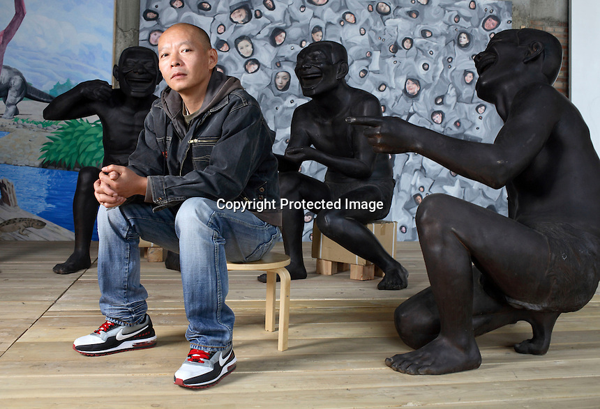 Yue Mingjun, a leading Chinese contemporary artist who is known for his painting and sculptures of large smiling faces, photographed at his studio in Beijing, China on 9 April, 2008.