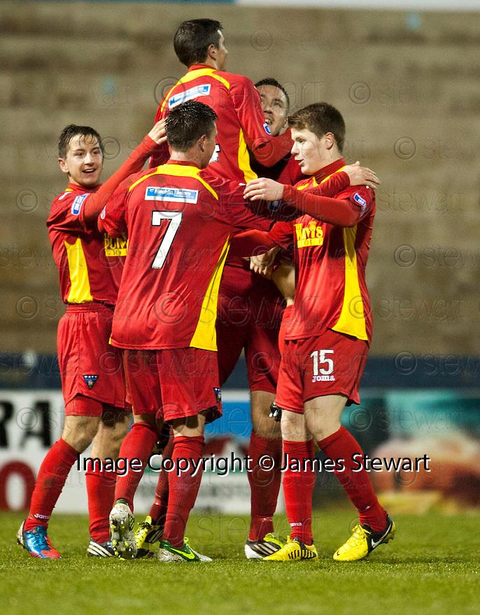 Pars' Stephen Husband celebrates with Craig Dargo  after he scores Dunfermline's third  ...