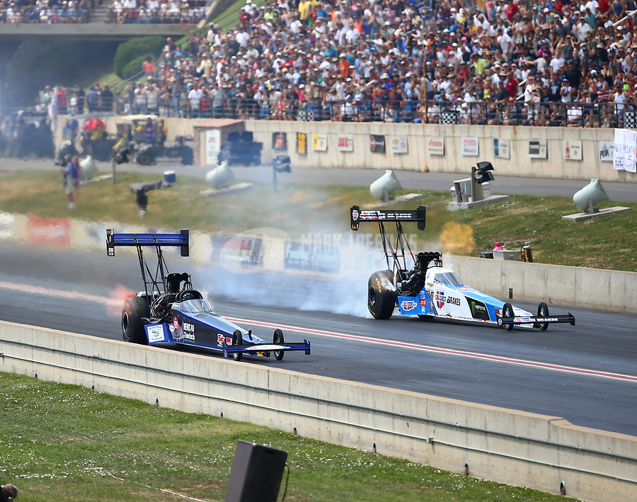 Jul 22, 2018; Morrison, CO, USA; NHRA top fuel driver Jim Maroney (near) defeats Brittany Force during the Mile High Nationals at Bandimere Speedway. Mandatory Credit: Mark J. Rebilas-USA TODAY Sports