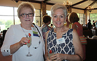 NWA Democrat-Gazette/CARIN SCHOPPMEYER Kitty Swank and Jane Vaughn visit at the ladies auxiliary luncheon.