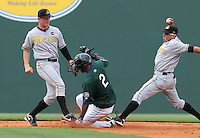 Right fielder Wilfred Pichardo (2) of the Greenville Drive slides safely into second as West Virginia Power shortstop Bengie Gonzalez (12) stretches to try to tag the base in a game against the Greenville Drive in a game on May 2, 2010, at Fluor Field at the West End in Greenville, S.C. Photo by: Tom Priddy/Four Seam Images