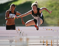 Wanganui's Phillipa Symes heads for victory in the women's under-16 hurdles final during day two of the National athletics championships at Newtown Park, Wellington, New Zealand on Saturday, 28 March 2009. Photo: Dave Lintott / lintottphoto.co.nz