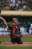 OAKLAND, CA - AUGUST 24:  Buster Posey #28 of the San Francisco Giants works behind the plate against the Oakland Athletics during the game at the Oakland Coliseum on Saturday, August 24, 2019 in Oakland, California. Both teams are wearing special uniforms for Players Weekend. (Photo by Brad Mangin)