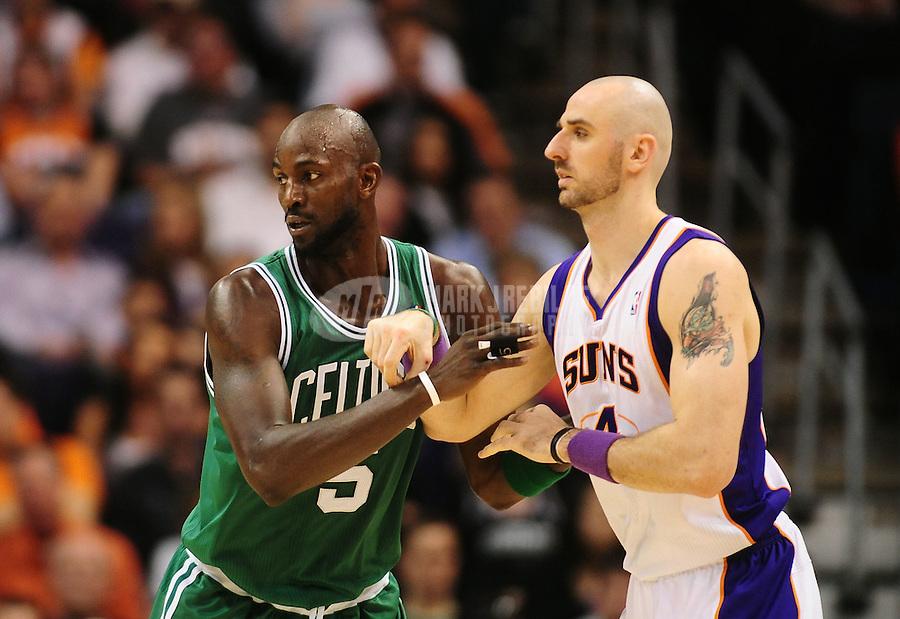Jan. 28, 2011; Phoenix, AZ, USA; Boston Celtics forward (5) Kevin Garnett against Phoenix Suns forward Marcin Gortat at the US Airways Center. Mandatory Credit: Mark J. Rebilas-