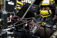 Feb 20, 2015; Chandler, AZ, USA; Detailed view as NHRA top fuel driver Richie Crampton holds the parachute handle and steering wheel during qualifying for the Carquest Nationals at Wild Horse Pass Motorsports Park. Mandatory Credit: Mark J. Rebilas-