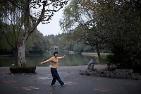 A Chinese woman performs morning exercise at Yangpu Park in Shanghai, China on November 7, 2009.