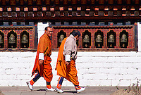Two men wearing traditional clothing in Paro, Bhutan