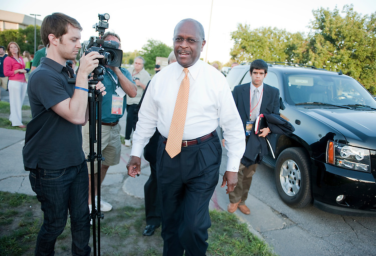 UNITED STATES - AUGUST 11:  Businessman Herman Cain arrives to Stephens Auditorium at Iowa State University for the Republican presidential debate in Ames, Iowa.  The debate will feature eight republican candidates including Cain.   (Photo By Tom Williams/Roll Call)