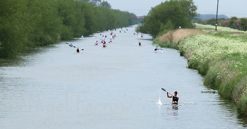 25 MAY 2014 - BRIGG, GBR - Steve King (GBR) (right) of Great Britain leads the field back to Brigg during the kayak at the World Quadrathlon Federation 2014 Middle Distance World Championships at the Brigg Bomber in  Lincolnshire in Great Britain (PHOTO COPYRIGHT © 2014 NIGEL FARROW, ALL RIGHTS RESERVED)