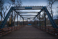 According to Bridgehunters.com:  Built 1891 by the Bullen Bridge Co.; modified 1928; replaced in 2001; reconstructed ca. 2004<br /> Through truss bridge over Arkansas River in Canon City<br /> Open to pedestrians only.     http://bridgehunter.com/category/city/canon-city-colorado/