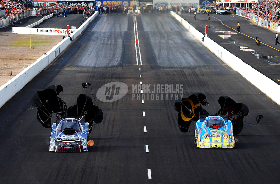 Feb. 21, 2010; Chandler, AZ, USA; NHRA funny car driver Tony Pedregon (right) defeats Del Worsham during the Arizona Nationals at Firebird International Raceway. Mandatory Credit: Mark J. Rebilas-