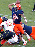Maryland Terrapins linebacker Darin Drakeford (52) puts pressure on Virginia Cavaliers quarterback Phillip Sims (14) during the game at Scott Stadium in Charlottesville, VA. Maryland defeated Virginia 27-20.