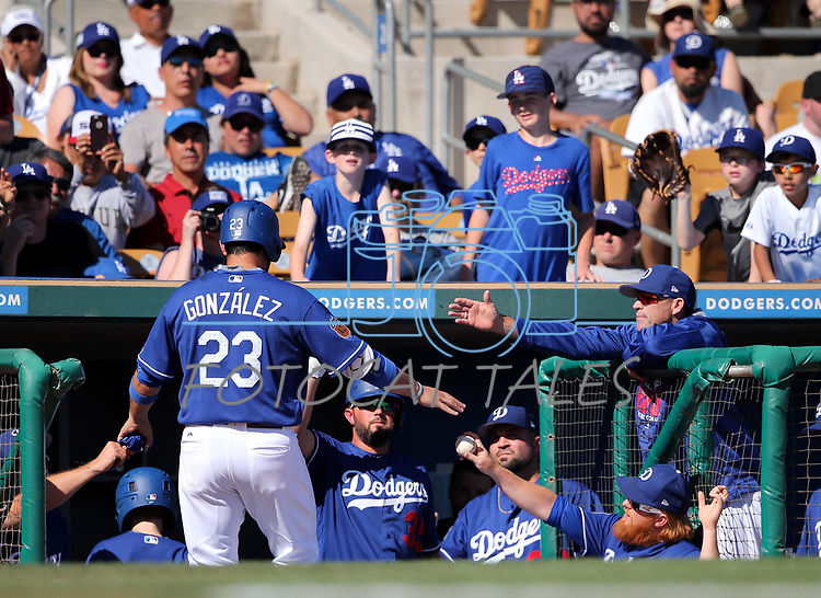 Los Angeles Dodgers' Adrian Gonzalez is greeted in the dugout after scoring against the Arizona Diamondbacks in a spring training game in Glendale, Ariz., on Friday, March 24, 2017.<br /> Photo by Cathleen Allison/Nevada Photo Source