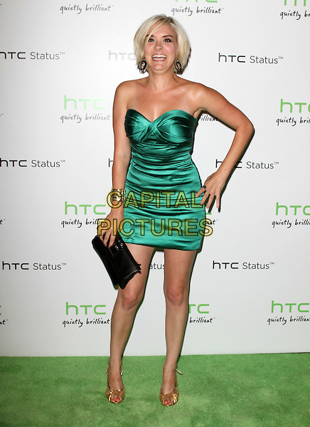 Brea Grant.The HTC Statusª Social Launch Event held at Paramount Studios in Hollywood, California, USA..July 19th, 2011.full length green strapless silk satin dress hand on hip black clutch bag funny smiling.CAP/ADM/KB.©Kevan Brooks/AdMedia/Capital Pictures.