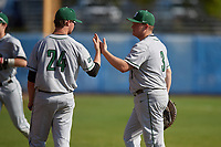 Dartmouth Big Green first baseman Michael Calamari (3) high fives Kade Kretzschmar (24) during a game against the Bradley Braves on March 21, 2019 at Chain of Lakes Stadium in Winter Haven, Florida.  Bradley defeated Dartmouth 6-3.  (Mike Janes/Four Seam Images)