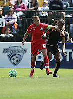 Abby Wambach (20) battles Kandace Wilson (9) for control of the ball. Washington Freedom defeated FC Gold Pride 4-3 at Buck Shaw Stadium in Santa Clara, California on April 26, 2009.