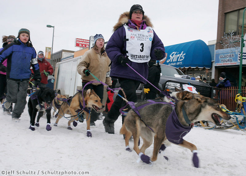 Jessie Royer runs her dogs to the start line in Anchorage on Saturday March 1st during the ceremonial start day of the 2008 Iidtarod Sled Dog Race.