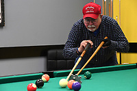 NWA Democrat-Gazette/J.T. WAMPLER Richard Allen of Springdale lines up a shot using a bridge while playing pool Thursday March 29, 2018 at the Springdale Senior Center. Allen and his friends meet twice a week to play pool and visit. The Redneck 5K & 1 Mile run/walk will be held Saturday March 31 with all proceeds going to the center's Meals on Wheels program. For more information go to www.springdalear.gov/596/Senior-Center