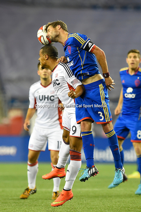 July 30, 2014 - Foxborough, Massachusetts, U.S. - Colorado Rapids' Drew Moor (3) heads the ball off of the top of New England Revolution's Charlie Davies' head during the MLS game between the Colorado Rapids and the New England Revolution held at Gillette Stadium in Foxborough Massachusetts. The New England Revolution defeated the Colorado Rapids 3-0. Eric Canha/CSM