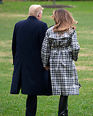United States President Donald J. Trump and First lady Melania Trump walk on the South Lawn of the White House in Washington, DC on Friday, November 9, 2018 en route to Paris, France where they will participate in the ceremonies commemorating the 100th anniversary of the end of World War I.<br /> Credit: Ron Sachs / CNP