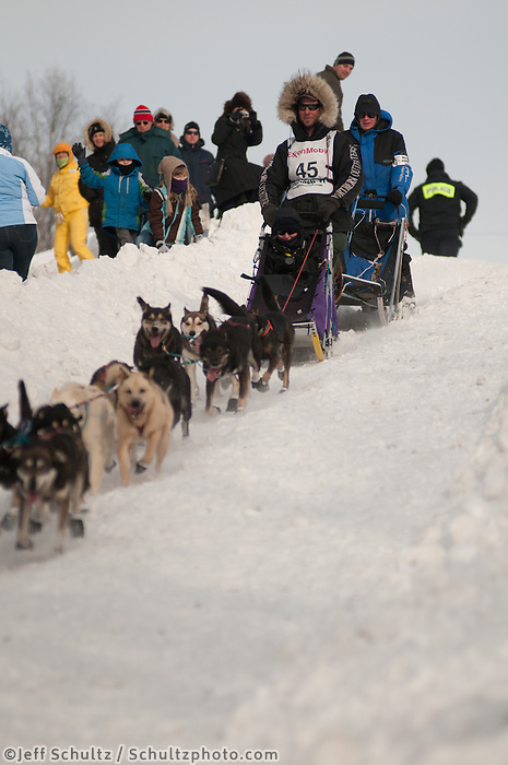 Musher Sven Haltman and Iditarider  Char McCaskey on Cordova street hill in downtown Anchorage, Alaska  during the ceremonial start of the 2011 Iditarod Trail Sled Dog Race