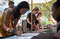 Matriculation for incoming first-years at the start of Occidental College's Fall Orientation for the class of 2023, Aug. 26, 2019. Students met Dean of Students Rob Flot in groups on the patio near Mitchell Garden. They also added their names to the official book of student names.<br /> (Photo by Marc Campos, Occidental College Photographer)