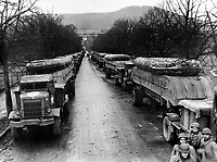 BNPS.co.uk (01202 558833)<br /> NARA/BNPS<br /> <br /> Truckloads of pontoon boats lined up for transport during the Allied drive towards the Rhine River. <br /> <br /> Remarkable rarely seen photos of heroic Allied soldiers fighting their way across Europe before crossing the River Rhine 75 years ago feature in a new book.<br /> <br /> They are published in Images of War, Montgomery's Rhine Crossing, which tells the story of the legendary offensive, nicknamed Operation Plunder, in March 1945.<br /> <br /> On the night of March 23, Field Marshal Bernard Montgomery's 21st Army Group launched a massive artillery, amphibious and airborne assault to breach the historic defensive water barrier protecting northern Germany.<br /> <br /> At the same time, the Americans, with the support of the British 6th Airborne Division, set in motion Operation Varsity - involving 16,000 paratroopers - on the east bank of the Rhine. They were dropped here to seize bridges to prevent German reinforcements from contesting the bridgeheads.<br /> <br /> Fierce fighting ensued, with much bloodshed on both sides as the Allies met determined resistance from machine gun nests. But the daring operation proved successful, helping to considerably shorten the war - the Nazis surrendered just six weeks later.