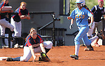 Coronado first baseman Taylor Woodford makes the play against Reed's Lindsay Yearman in the 4A softball state tournament at the University of Nevada, Reno on Friday, May 19, 2012. Coronado won 6-1 to advance to Saturday's championship game..Photo by Cathleen Allison