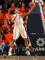 Dec. 18, 2010; Charlottesville, VA, USA; Virginia Cavaliers center Simone Egwu (4) grabs a rebound in front of UMBC Retrievers guard Kristin Coles (22) during the game at the John Paul Jones Arena.  Mandatory Credit: Andrew Shurtleff