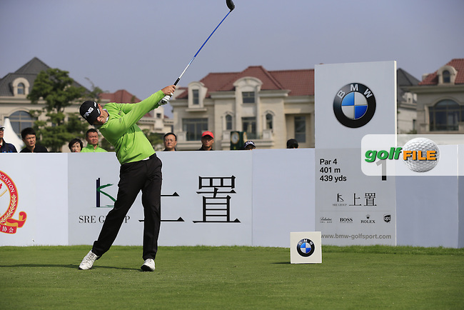 Luke Guthrie (USA) tees off the 1st tee to start his match during Saturday's Round 3 of the 2013 BMW Masters presented by SRE Group held at Lake Malaren Golf Club, Shanghai, China. 26th October 2013.<br /> Picture: Eoin Clarke/www.golffile.ie