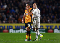 Jake Livermore of Hull City and Jonjo Shelvey of Swansea City during the Capital One Cup match between Hull City and Swansea City played at the Kingston Communications Stadium, Hull