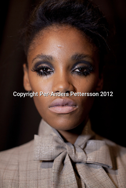JOHANNESBURG, SOUTH AFRICA – MARCH 08: A model backstage before the show with designer Abigail Betz at the Joburg Fashion Week on March 08 2012, at the Hyde Park Mall in Johannesburg, South Africa. South Africa's finest designers showed their 2012 Autumn & Winter collections during the 4-day event. (Photo by Per-Anders Pettersson)