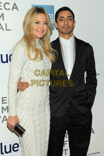 "Kate Hudson & Riz Ahmed.2013 Tribeca Film Festival Premiere of ""The Reluctant Fundamentalist"" held at the Tribeca Performing Arts Center, New York, NY., USA..April 22nd, 2013.half length white dress gold beads beaded arm around waist shirt suit.CAP/LNC/TOM.©LNC/Capital Pictures."