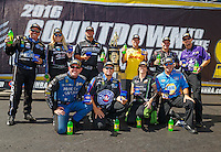 Sep 18, 2016; Concord, NC, USA; NHRA funny car drivers (front row from left) Tommy Johnson Jr , Robert Hight , Alexis DeJoria , Ron Capps (back row from left) John Force , Courtney Force , Matt Hagan , Del Worsham , Tim Wilkerson and Jack Beckman pose with the championship trophy prior to the Carolina Nationals at zMax Dragway. Mandatory Credit: Mark J. Rebilas-USA TODAY Sports