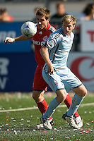 12 September 2009: Colorado Rapids forward Jacob Peterson #15 and Toronto FC midfielder Jim Brennan #11 in action during MLS action at BMO Field Toronto in a game between Colorado Rapids and Toronto FC. .Toronto FC won 3-2..