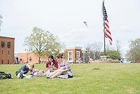 Group of three students studying on Drill Field grass.<br />  (photo by Robert Lewis / &copy; Mississippi State University)