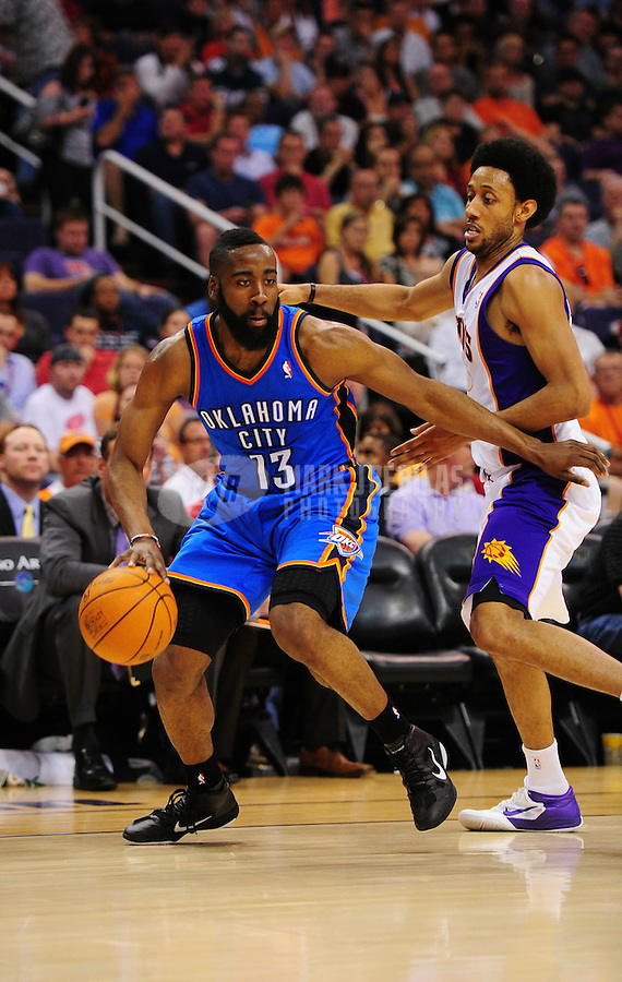 Mar. 30, 2011; Phoenix, AZ, USA; Oklahoma City Thunder guard (13) James Harden drives to the basket against Phoenix Suns guard Josh Childress at the US Airways Center. Mandatory Credit: Mark J. Rebilas-