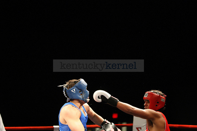 Phi Kappa Psi Evan Fisher, left, and Alpha Tau Omega Frederick Williams, right, box at The Main Event at the Lexington Convention Center in Lexington, Ky., on Thursday, November 7, 2013. Photo by Tessa Lighty | Staff