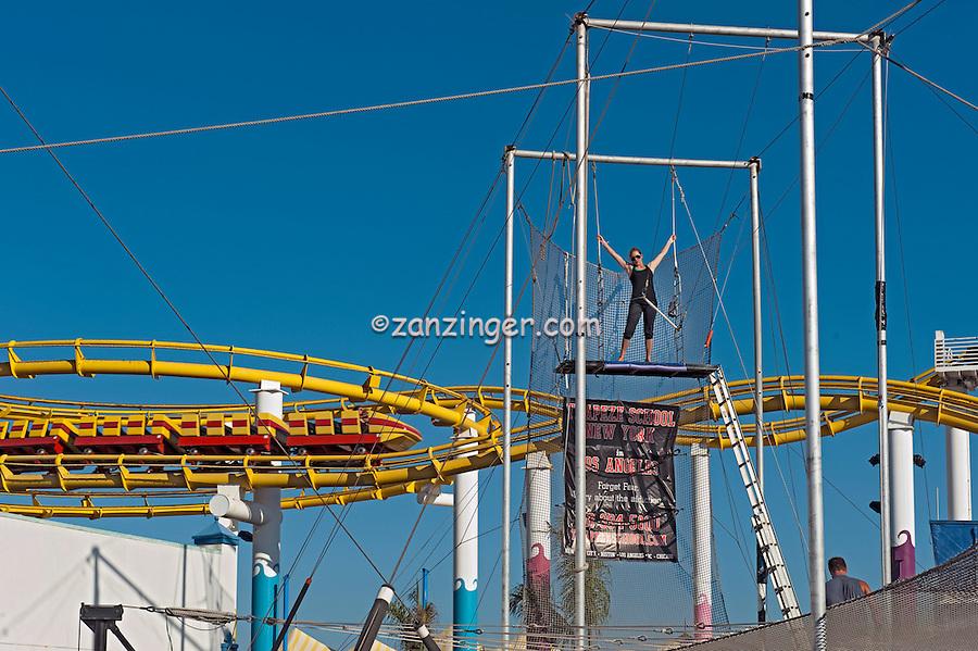 Santa Monica CA, Santa Monica Pier,Trapeze, Pacific Park, California, Santa Monica Pier, Santa Monica CA, Pacific Park Amusements, Roller Coaster, Ferris Wheel, Over Water, mix of stores, restaurants,  Beautiful