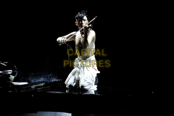 Amadeus Leopold (Yoo Hanbin) performing at Yoko Ono's Meltdown Festival, Queen Elizabeth Hall, London, England. <br /> 18th June 2013<br /> on stage in concert live gig performance music full length kneeling on grand piano knotted fisherman trousers violin topless chest<br /> CAP/MAR<br /> &copy; Martin Harris/Capital Pictures