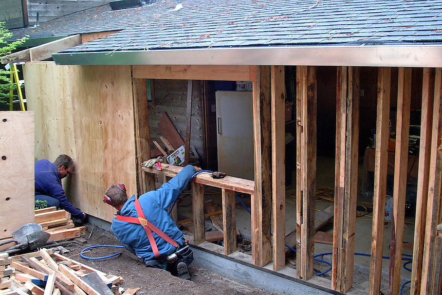 Construction workers put the sheathing over the rough framing in residential construction in Sonoma County California